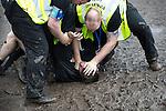 © Joel Goodman - 07973 332324 . . 12/06/2016 . Manchester , UK . Security detain a man at the Parklife music festival at Heaton Park in Manchester . Photo credit : Joel Goodman