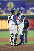 Winston-Salem Dash catcher Omar Narvaez (22) has a meeting on the mound with starting pitcher Carson Fulmer (16) during the game against the Carolina Mudcats at BB&T Ballpark on July 23, 2015 in Winston-Salem, North Carolina.  The Dash defeated the Mudcats 3-2.  (Brian Westerholt/Four Seam Images)