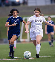 Kaylee Vorisek (21) of Bentonville fight for ball with Unknown #21 of Rogers Heritage at David Gates Stadium, Rogers, Ark., on Tuesday,, March 30, 2021  / Special to NWA Democrat-Gazette/ David Beach