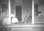 Summer Porch Scene: The house at 1821 South 16th Street was the home of Julius and Tillie Miller in 1912 and 1913. He was listed as a glazier with a glass company as well as a laborer.<br /> <br /> <br /> Photographs taken on black and white glass negatives by African American photographer(s) John Johnson and Earl McWilliams from 1910 to 1925 in Lincoln, Nebraska. Douglas Keister has 280 5x7 glass negatives taken by these photographers. Larger scans available on request.