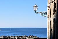 - landscape with house, lamp-post and sea in Riomaggiore village (Cinque Terre)....- paesaggio con casa, lampione e mare nel paese di Riomaggiore (Cinque Terre)