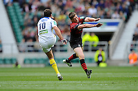 Owen Farrell of Saracens attempts to block the clearance kick of Brock James of ASM Clermont Auvergne during the Heineken Cup semi-final match between Saracens and ASM Clermont Auvergne at Twickenham Stadium on Saturday 26th April 2014 (Photo by Rob Munro)