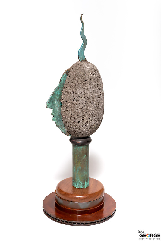 Title: Easter Island<br /> Materials: Volcanic Rock, Bronze, Copper and Oak<br /> Size: 31Tx11x11<br /> Price: Available on Request