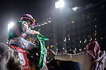 DUBAI, UNITED ARAB EMIRATES - MARCH 25: Mike Smith atop Arrogate #9, receives a flag from a local, after winning the Dubai World Cup at Meydan Racecourse during Dubai World Cup Day on March 25, 2017 in Dubai, United Arab Emirates. (Photo by Douglas DeFelice/Eclipse Sportswire/Getty Images)