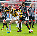 Par's Lawrence Shankland and East Fife's Lewis Barr challenge for the ball.