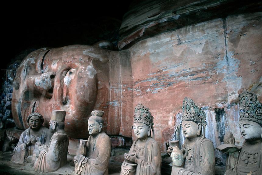 Stone carvings of Baobing Buddha Pilgrims at Dazu in China.