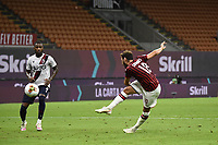Hakan Calhanoglu of AC Milan scores a goal during the Serie A football match between AC Milan and Bologna FC at stadio Giuseppe Meazza in Milano ( Italy ), July 18th, 2020. Play resumes behind closed doors following the outbreak of the coronavirus disease. <br /> Photo Image Sport / Insidefoto