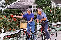 Senior couple enjoying a rose garden on a bike ride.