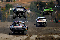 Dec. 18, 2009; Lake Elsinore, CA, USA; LOORRS Robby Woods (bottom left) leads a pack of drivers during qualifying for the Lucas Oil Challenge Cup at the Lake Elsinore Motorsports Complex. Mandatory Credit: Mark J. Rebilas-US PRESSWIRE