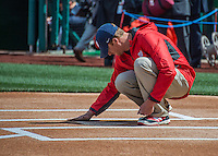 7 April 2016: A member of the Grounds Crew perfects the dirt at home plate prior to the Washington Nationals Home Opening Game against the Miami Marlins at Nationals Park in Washington, DC. The Marlins defeated the Nationals 6-4 in their first meeting of the 2016 MLB season. Mandatory Credit: Ed Wolfstein Photo *** RAW (NEF) Image File Available ***