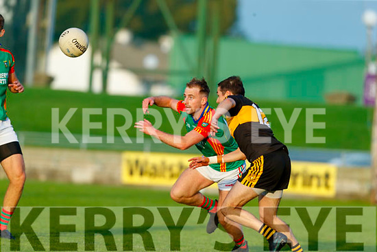 David Roche, Mid Kerry in action against Brian Looney, Dr. Crokes during the Kerry County Senior Football Championship Semi-Final match between Mid Kerry and Dr Crokes at Austin Stack Park in Tralee, Kerry.
