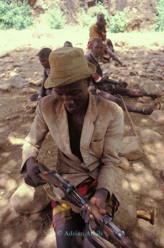 A Turkana nomad protects his family & herd of  goats with a  World War 1 bolt action rifle in the Turkana region of Northern Kenya.  With the proliferation of    weapons in the region (Lokitang on the border with South Sudan)  violent conflict has increased dramatically.