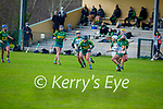 Jessica Fitzell of Kerry takes to the ground running as  Meave Clince and Claire Coffey of Meath look on in the Camogie Intermediate Championship