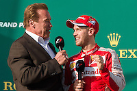 March 15, 2015: Arnold Schwarzenegger congratulates Sebastian Vettel (DEU) #5 (3rd) on the podium at the 2015 Australian Formula One Grand Prix at Albert Park, Melbourne, Australia. Photo Sydney Low