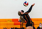PLYMOUTH, CT-111020JS16 —Terryville Jessie Valentine (5) gets the ball over the net during their match against Wolcott Tech Tuesday at Terryville High School. <br /> Jim Shannon Republican-American