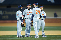 (L-R) Grant Van Scoy (27), Kellen Sarver (18), Cam McDonald (29), and Branden Comia (20) huddle up during a pitching change against the Wake Forest Demon Deacons at David F. Couch Ballpark on February 16, 2019 in  Winston-Salem, North Carolina.  The Fighting Illini defeated the Demon Deacons 5-2. (Brian Westerholt/Four Seam Images)
