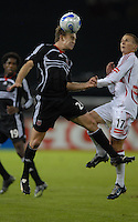 DC United defender Bryan Namoff (26) heads the ball against Chicago Fire midfielder Chris Rolfe (17).  D. C. United tied the Chicago Fire 2-2 during the second leg of the MLS Eastern Conference Semifinals at RFK Stadium in Washington, DC, on November 1, 2007. The Chicago Fire advance to the Eastern Conference Finals after beating DC United 3-2 on aggregate.