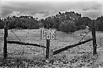 Think God, Born again Christian movement sign fixed to a fence enclosing barren land. Big Spring, Howard County, Texas 1999