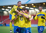 Dunfermline v St Johnstone..24.12.11   SPL .Liam Craig is mobbed after scoring the thrid goal by Jody Morris, Murray Davidson and Chris Millar.Picture by Graeme Hart..Copyright Perthshire Picture Agency.Tel: 01738 623350  Mobile: 07990 594431