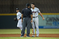 Mandy Alvarez (24) of the Scranton/Wilkes-Barre RailRiders argues with umpire Charlie Ramos after having been called out attempting to steal second base during the game against the Gwinnett Stripers at Coolray Field on August 17, 2019 in Lawrenceville, Georgia. The Stripers defeated the RailRiders 8-7 in eleven innings. (Brian Westerholt/Four Seam Images)