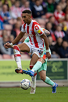 11th September 2021;  Bet365 Stadium, Stoke, Staffordshire, England; EFL Championship football, Stoke City versus Huddersfield Town; Jacob Brown of Stoke City is tackled by Josh Koroma of Huddersfield Town