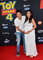 "LOS ANGELES, USA. June 12, 2019: Mario Lopez & Courtney Laine Mazza at the world premiere of ""Toy Story 4"" at the El Capitan Theatre.<br /> Picture: Paul Smith/Featureflash"