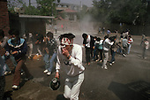 """Seoul, South Korea.May 8, 1987..Students hold a violent anti-government protests at Yunsei University...After two decades of building an economic miracle, in the summer of 1987 tens of thousands of frustrated South Korean students took to the streets demanding democratic reform. """"People Power"""" Korean-style saw Koreans from all social spectrums join in the protests...With the Olympics to be held in South Korea in 1988, President Chun Doo Hwan decided on no political reforms and to choose the ruling party chairman, Roh Tae Woo, as his heir. The protests multiplied and after 3 weeks Chun conceded releasing oppositionist Kim Dae Jung from his 55th house arrest and shaking hands with opposition leader Kim Young Sam. Days later he endorsed presidential elections and an amnesty for nearly 3,000 political prisoners. It marked the first initiative of democratic reform in South Korea and the people had their victory."""