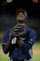 AZL Padres relief pitcher Cristian Machuca (11) looks to the sky as he walks off the field between innings during a game against the AZL Cubs on August 28, 2017 at Sloan Park in Mesa, Arizona. AZL Cubs defeated the AZL Padres 2 9-4. (Zachary Lucy/Four Seam Images)