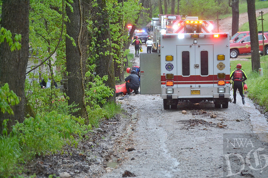 Rustic Drive in Little Flock was blocked as Bella Vista, Rogers and Little Flock Fire Department work to rescue people stranded by the rising water Wednesday morning.<br />(Pea Ridge Times/Annette Beard)