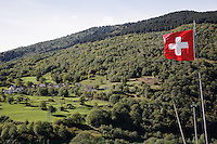 Switzerland. Canton of Ticino. Val di Blenio (Blenio valley). Village of Ponto Valentino. Swiss flag flying in the wind. © 2006 Didier Ruef