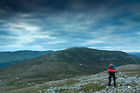 A walker looking towards the Munro of Geal Charn from A'Mharconaich, Monadhliath, Cairngorm National Park, Highlands<br /> <br /> Copyright www.scottishhorizons.co.uk/Keith Fergus 2011 All Rights Reserved