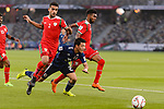 Doan Ritsu of Japan (C) gets tripped as he is tackled by Mohammed Al Musallami (L) and Raed Saleh of Oman (R) during the AFC Asian Cup UAE 2019 Group F match between Oman (OMA) and Japan (JPN) at Zayed Sports City Stadium on 13 January 2019 in Abu Dhabi, United Arab Emirates. Photo by Marcio Rodrigo Machado / Power Sport Images