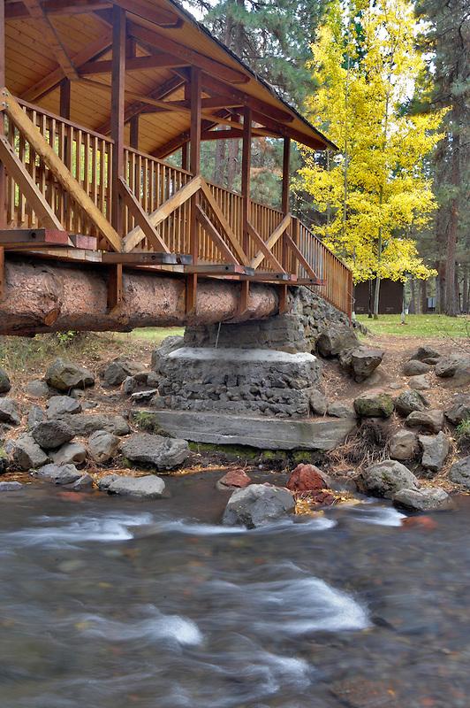 Creekside City Park bridge with fall colored aspens. Sisters. Oregon