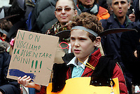 "Scolari ed insegnanti del VII Circolo Montessori protestano contro i tagli indossando orecchie d'asino di carta davanti al Ministero dell'ìstruzione a Roma, 29 novembre 2010..A pupil wearing paper-made donkey ears holds a sign reading ""We won't bocome donkeys"" during a protest against cuts to school in front of the Education Ministry headquarters in Rome, 29 november 2010..UPDATE IMAGES PRESS/Riccardo De Luca"