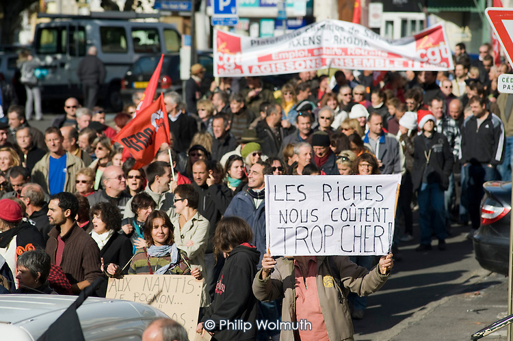 The Rich Cost Us Too Much. Workers and students in the ex-coalmining town of Alès, in southern France, join a day of nationwide protest against the Sarkozy government's proposed pension reforms.