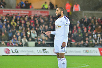 Pictured: Friday 26 December 2014<br /> Re: Premier League, Swansea City FC v Aston Villa at the Liberty Stadium, Swansea, south Wales, UK.<br /> <br /> Swansea's Ashley Williams