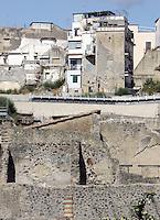 Una veduta del sito archeologico romano e le costruzioni moderne, sullo sfondo, ad Ercolano, nei pressi di Napoli.<br /> Roman ruins and modern buildings in background in Ercolano, near Naples.<br /> UPDATE IMAGES PRESS/Riccardo De Luca