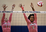 Marymount's Bri Fitzpatrick, left, and Cailyn Thomas go up for a block during a college volleyball match against Shenandoah at Marymount University in Arlington, Vir., on Tuesday, Oct. 8, 2013.<br /> Photo by Cathleen Allison