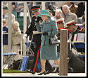 24/05/2002                   Copyright Pic : James Stewart.File Name : stewart-queen falkirk  04.QUEEN ELIZABETH II HOLDS ON TO HER HAT AS SHE WALKS ALONG THE JETTY TO OFFICIALLY OPEN THE FALKIRK WHEEL.....Payments to :-.James Stewart Photo Agency, 19 Carronlea Drive, Falkirk. FK2 8DN      Vat Reg No. 607 6932 25.Office     : +44 (0)1324 570906     .Mobile  : +44 (0)7721 416997.Fax         :  +44 (0)1324 570906.E-mail  :  jim@jspa.co.uk.If you require further information then contact Jim Stewart on any of the numbers above.........
