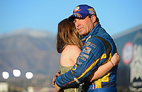Nov. 11, 2012; Pomona, CA, USA: NHRA funny car driver Ron Capps (right) cries as he embraces daughter Taylor Capps after losing the 2012 championship during the Auto Club Finals at at Auto Club Raceway at Pomona. Mandatory Credit: Mark J. Rebilas-