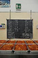 """Roma.Rome.Italia.Italy.Casa di reclusione di Rebibbia.Le cucine.I lavoratori detenuti cucinano i pasti.Elenco dei detenuti.List of prisoners...""""Liberamens...a"""" è un progetto della Syntax error che gestisce la mensa per circa 300 detenuti..Rebibbia prison. Kitchens. Workers prisoners cook meals. """"Liberamens...a """" is a project of """"Syntax error"""", which manages the canteen for about 300 inmates.."""