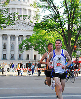 The top two runners round the bend at the State Capitol at the 2010 Syttende Mai between Madison and Stoughton, Wisconsin on Saturday, 5/15/10