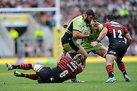 Alex Corbisiero of Northampton Saints is tackled by Kelly Brown and Brad Barritt of Saracens during the Aviva Premiership Final between Saracens and Northampton Saints at Twickenham Stadium on Saturday 31st May 2014 (Photo by Rob Munro)