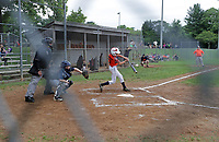 ALTERED STATE PHOTO ESSAY/ANDREW SHURTLEFF<br /> A batter hits the ball during a Central Little League baseball championship game at Penn Park. <br /> <br /> Shut downs and stay-in-place orders, the most recent of which came from Gov. Ralph Northam Monday, have left Charlottesville dormant. Students have been sent home, many businesses have shut their doors and events have been canceled. In this photo essay, photographer Andrew Shurtleff has spent time capturing the effects of the pandemic and comparing the duality of the present with our social past.