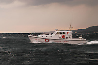 - motor patrol boat of the Coastguard in navigation with stormy sea....- motovedetta della Guardia Costiera in navigazione con mare agitato