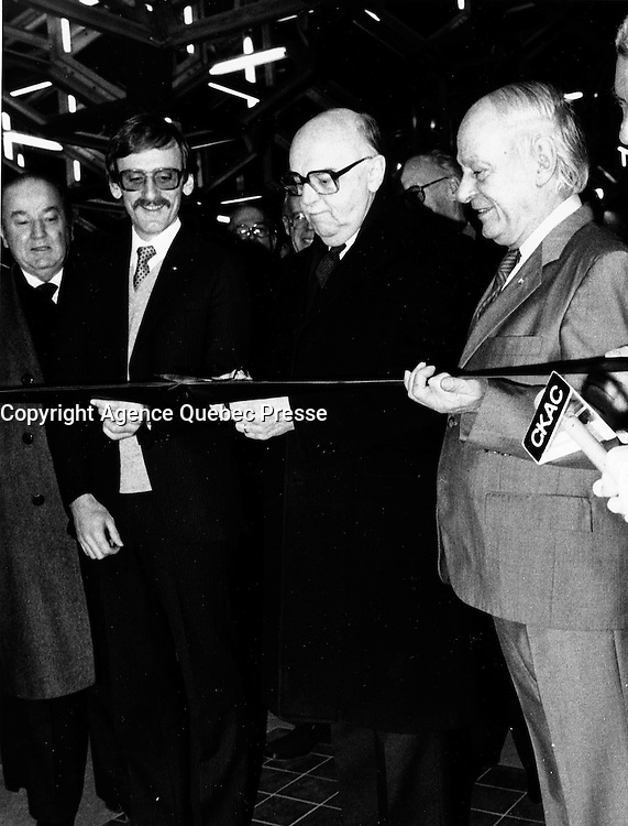 Montreal (QC) CANADA  January 11 , 1984 file photo -Michel Clair, Quebec Minister of Ransport (L) Jean Drapeau, Montreal Mayor (M), and Rene Levesque , Quebec Premier (R) cut the ribbon  at the inauguration of the metro orange line extension to Du College  station<br /> <br /> <br />  - Rene Levesque