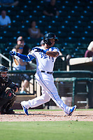 Surprise Saguaros designated hitter Meibrys Viloria (9), of the Kansas City Royals organization, follows through on his swing in front of catcher Daulton Varsho (8) during an Arizona Fall League game against the Salt River Rafters on October 9, 2018 at Surprise Stadium in Surprise, Arizona. Salt River defeated Surprise 10-8. (Zachary Lucy/Four Seam Images)