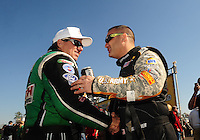 Mar. 13, 2011; Gainesville, FL, USA; NHRA top fuel dragster driver Tony Schumacher (right) with funny car driver John Force during the Gatornationals at Gainesville Raceway. Mandatory Credit: Mark J. Rebilas-
