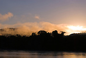 Pará State, Brazil. A misty sunrise on the Xingu River.