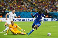 Mario Balotelli of Italy takes on Goalkeeper Joe Hart and Gary Cahill of England